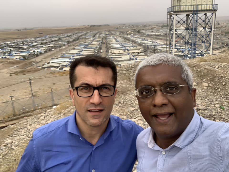With Dr Marwan Baker, the founder of Bring Hope Humanitarian Foundation in front of the Kawergosk Refugee camp.